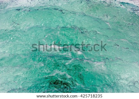 Wave of a ferry ship on the open ocean. Transparent sea water foam behind boat. Boat wake in green sea. Big waves behind the boat. - stock photo