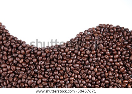 Wave of coffee beans on white background - stock photo
