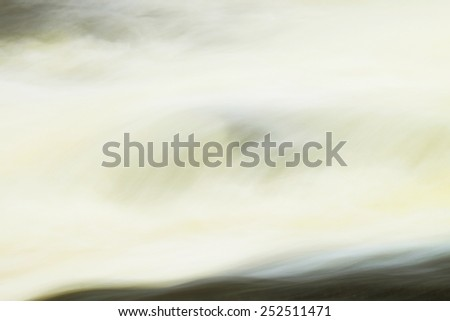 Wave of rapid stream with huge of water. Mountain river full of cold spring water. Slipper big stones and foamy chilly water around.  - stock photo