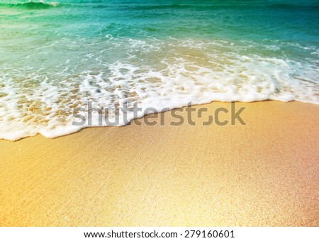 Wave of sea water and sand - stock photo