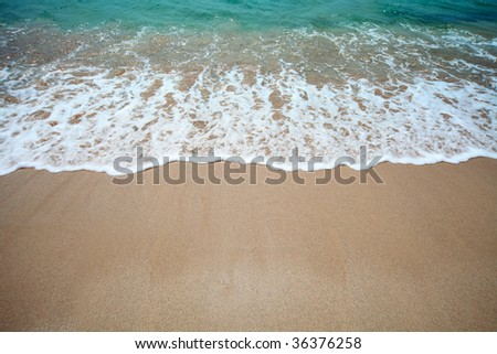 Wave of water and sand - stock photo