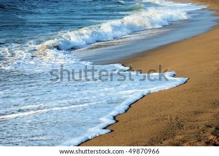 wave on a beach of mediterranean sea in barcelona - stock photo