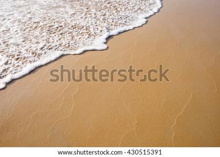 Wave on beach. - stock photo
