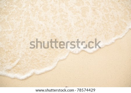 Wave on beach - stock photo