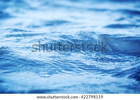 wave on the clean beautiful blue water close up, low Angle view - stock photo