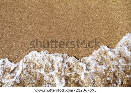 wave on the sand - stock photo