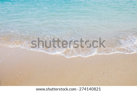 Wave roll into beach with white clean foam - stock photo