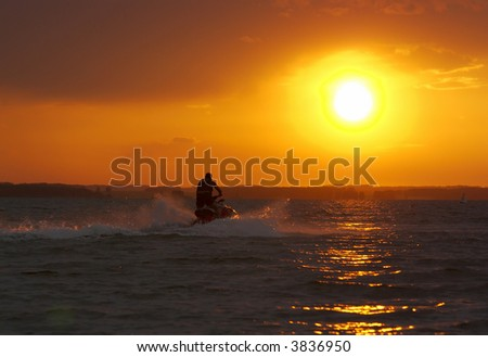wave runner during sundown scenic