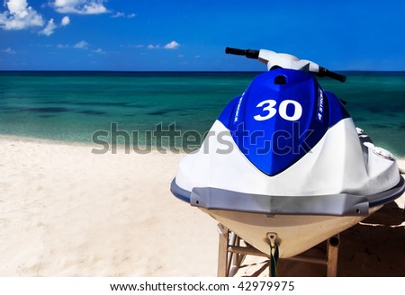 wave runner, jet skis, and watercraft on the Caribbean Beach - stock photo
