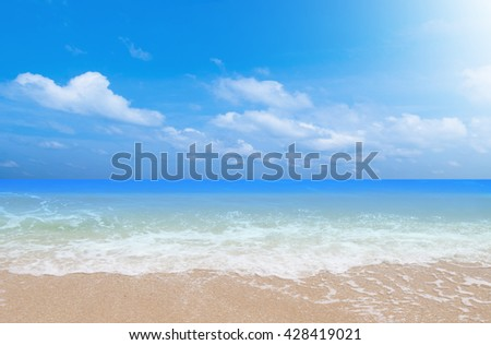 Wave & Sand beach with blue sky background