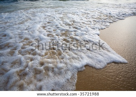 Wave seacoast in evening. - stock photo