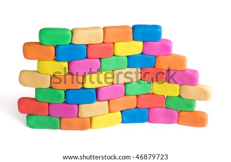 Wave shaped piece of wall made of colorful child's play clay bricks. Flexibility concept - stock photo