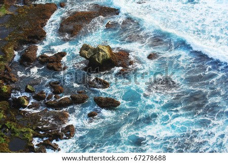 wave splashing stone - stock photo