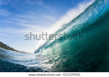 Wave Swimming Closeup Ocean wave hollow crashing tube water power swimming closeup.,