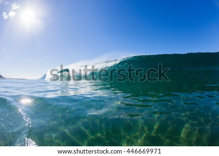 Wave Swimming Wave inside hollow crashing blue ocean water swimming photo.