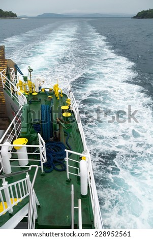 wave trail behind the stern of the ship - stock photo