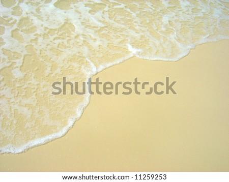 Wave washing on Whitehaven Beach, Whitsundays, Queensland, Australia.  Copy Space. - stock photo