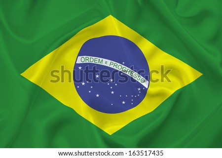 Waved Brazilian flag. Green, yellow and blue are the colors of Brazil. Ordem e Progresso.