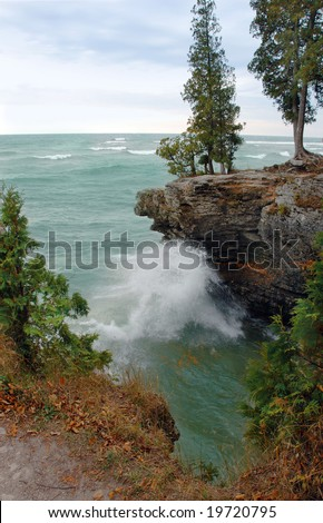 Waves along the rocky coast of Lake Michigan - stock photo