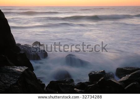 Waves at sunrise - stock photo