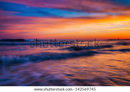 Waves at sunset, Cape May, New Jersey. - stock photo