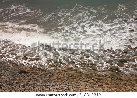 waves breaking into Sponge Bay, Gisborne, East Coast, North Island, New Zealand  - stock photo