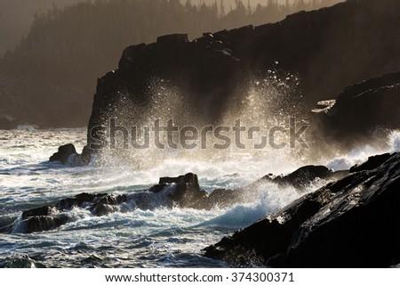 Waves breaking on the coastline. - stock photo