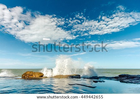 Waves breaking on the rocks at sunset on a beach in Mar del Plata, Argentina