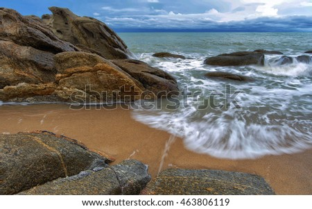 Waves breaking on the shore with sea