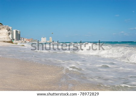 Waves breaking over the white sand, Cancun, Mexico - stock photo