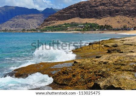 Waves crashing against a rocky coast - stock photo