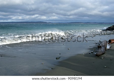 waves crashing on a beach - stock photo