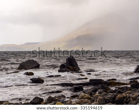Waves crashing on rocks on beach in rough weather, Elgol, Isle of Skye, Scotland, UK