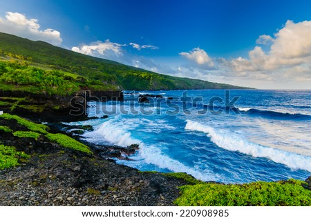 Waves crashing on the beach with a spectacular ocean view on the Road to Hana, Maui, Hawaii, USA - stock photo