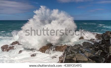 Waves crashing on the reef at queen's bath, Kauai, Hawaii - stock photo