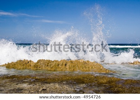 Waves crashing on the rocky shore - stock photo