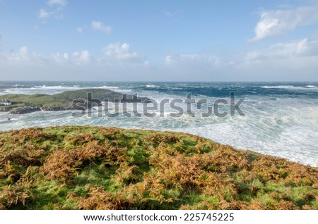 Waves crashing on the shore on a stormy day in Ireland - stock photo