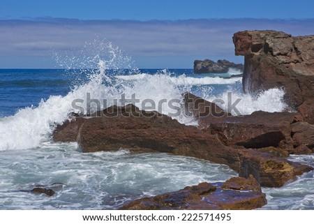 Waves crashing onto rocks - stock photo