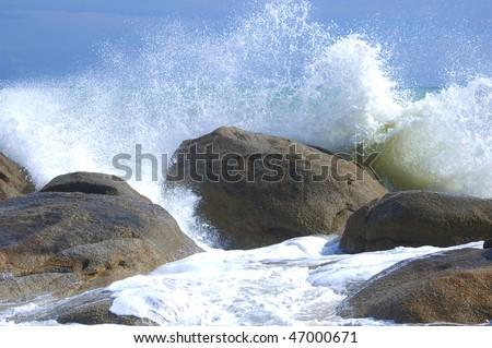 Waves crushing into the rocks (Koh Samui, Thailand) - stock photo