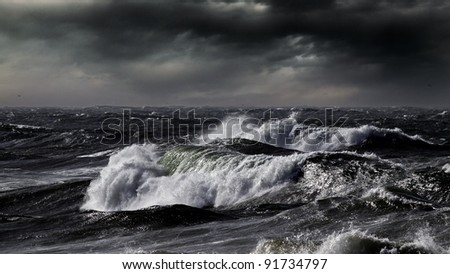 Waves during a storm in the north Portuguese coast - enhanced sky - stock photo