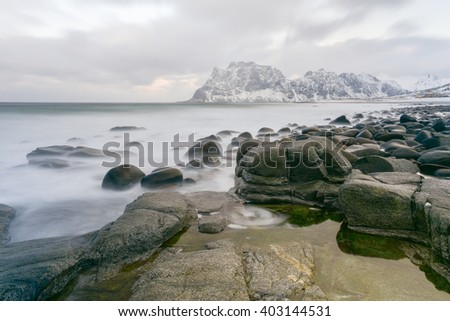 Waves flowing over Utakleiv Beach, Lofoten Islands, Norway in the winter.