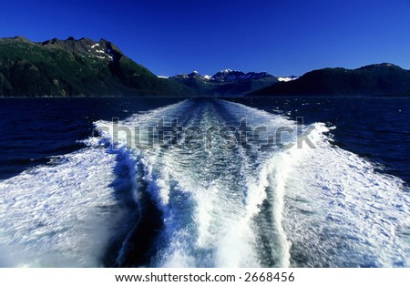Waves from a speed boat. - stock photo
