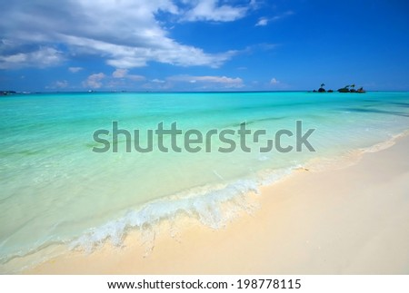 Waves hit the tropics beach - stock photo