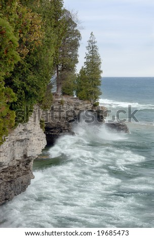 Waves hitting the rocky coast of Lake Michigan in Door County, Wisconsin. - stock photo