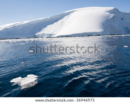 waves in front of glacier - stock photo