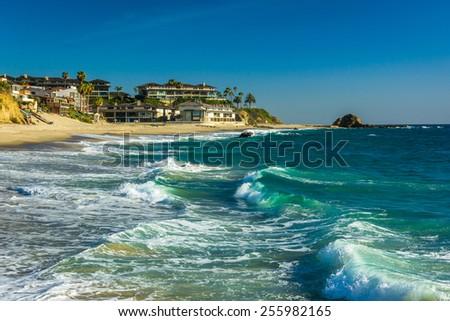 Waves in the Pacific Ocean at Victoria Beach, in Laguna Beach, California. - stock photo