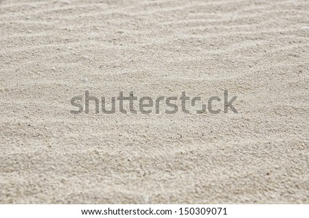 Waves in the sand on a beach made by a gentle breeze. - stock photo