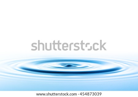 Waves in water after falling a drop - stock photo