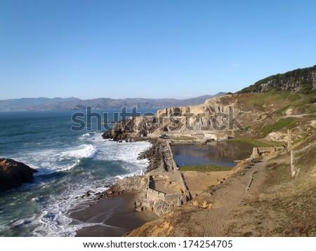 Waves lap against the Sutro Baths in San Francisco, California - stock photo