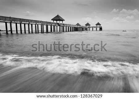 Waves motion at beach in black and white - stock photo